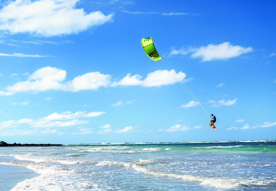 sky water kitesurfing sports kite sports windsports Ocean water sport toy individual sports boardsport surfing extreme sport wind wave surface water sports wind day wave shore