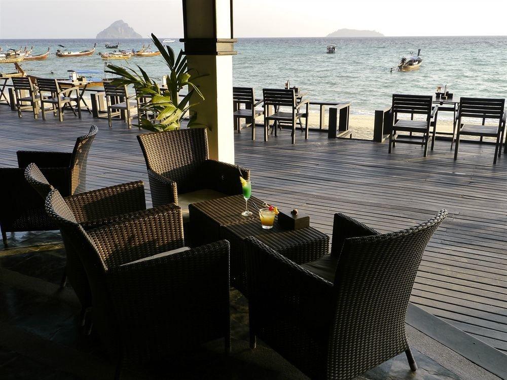 sky water chair property Ocean outdoor structure overlooking shore lined