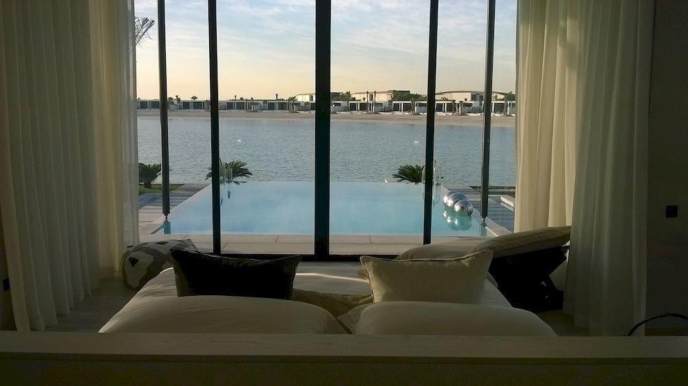 water property condominium house overlooking home Ocean swimming pool living room