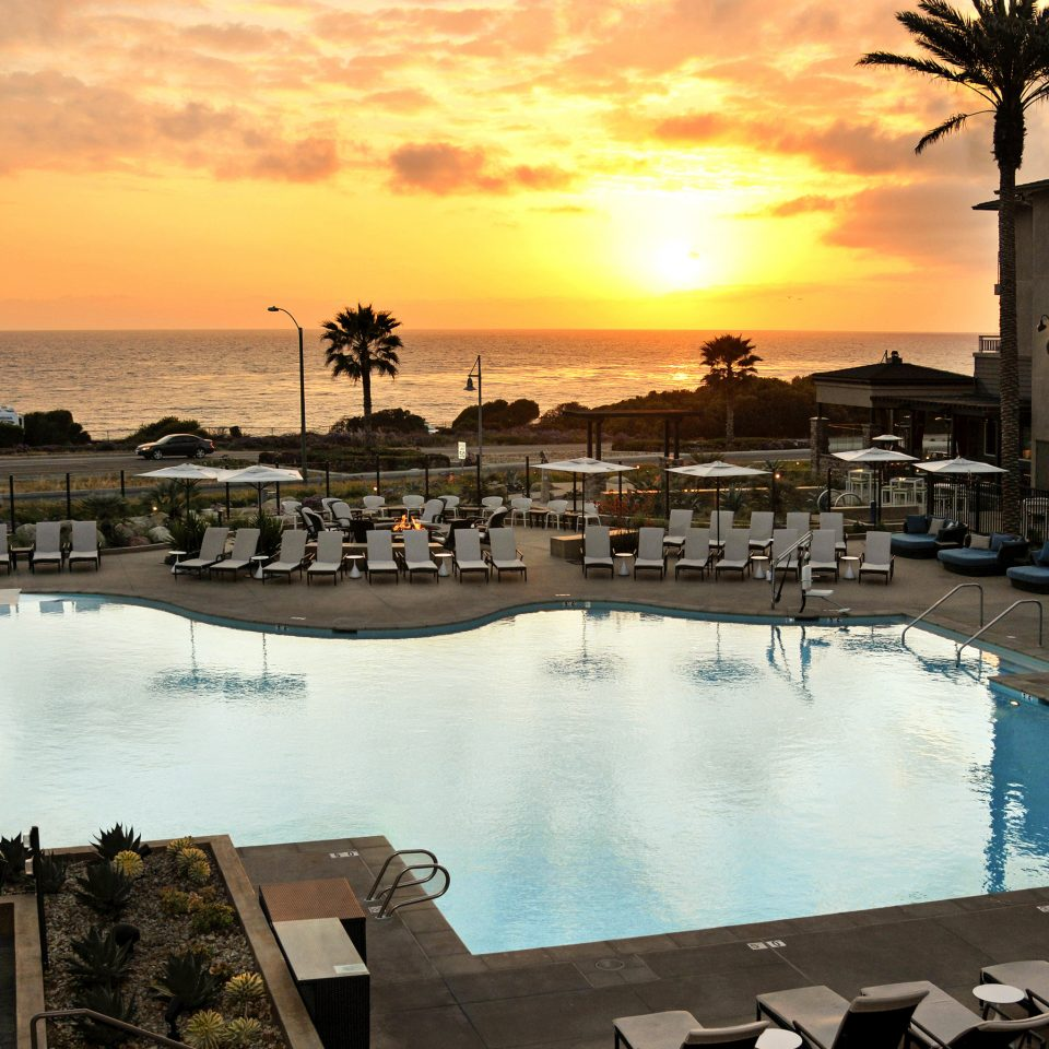 Ocean Patio Pool Scenic views Sunset Waterfront sky water marina scene dock Sea evening Resort swimming pool dusk set