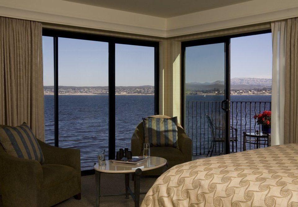water property chair overlooking condominium Ocean living room Suite home Resort Villa cottage