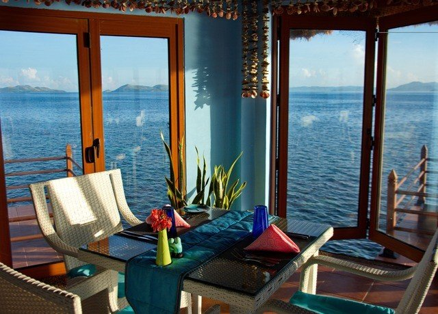 water chair property leisure Resort Ocean house Villa home cottage caribbean Suite overlooking condominium living room shore