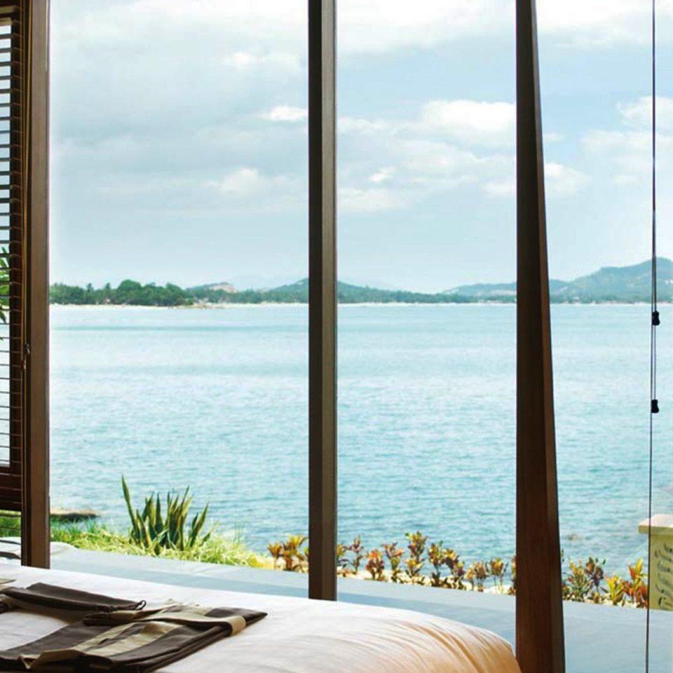water Ocean overlooking chair property condominium building facing home Resort Villa nice window treatment day