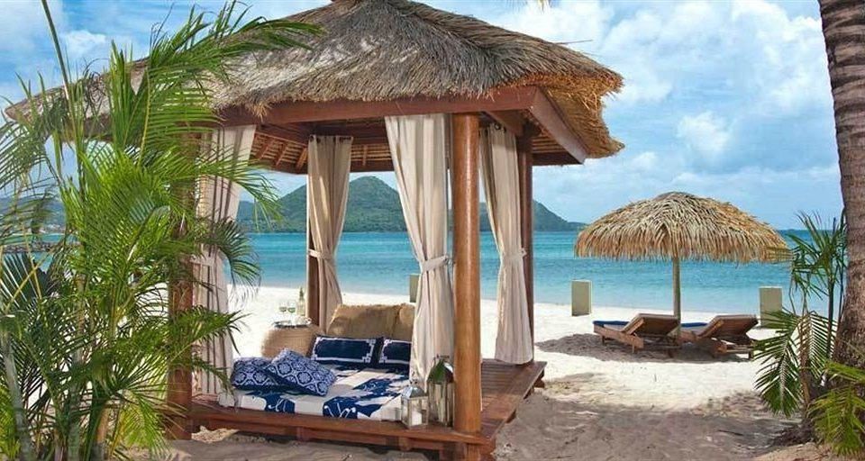 water sky property chair Resort Villa hut cottage Ocean caribbean eco hotel lawn hacienda palm shade sandy