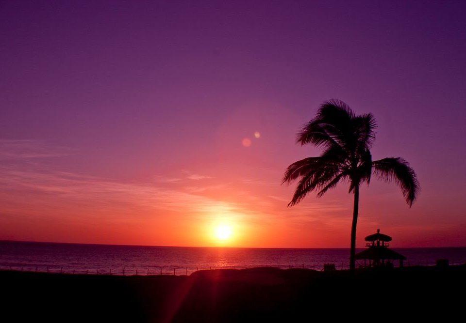sky water Sunset afterglow horizon sunrise red sky at morning dawn dusk morning evening cloud Ocean Sea Sun distance
