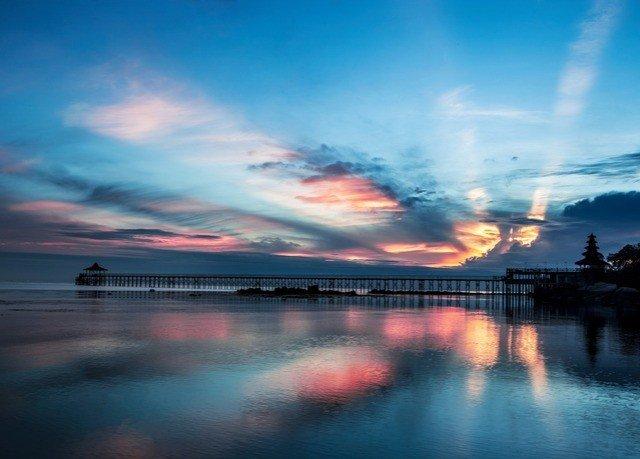 water sky horizon afterglow cloud sunrise dawn atmosphere Sea Sunset dusk evening pier morning scene Ocean sunlight blur