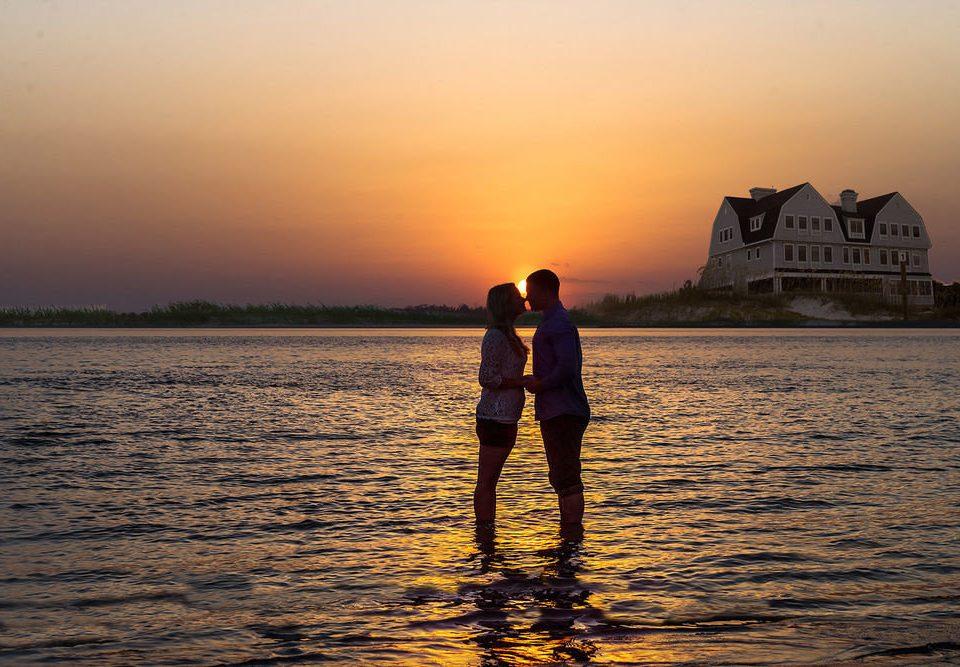 water sky man Sunset horizon atmospheric phenomenon Sea morning shore sunrise Ocean evening dawn dusk sunlight distance