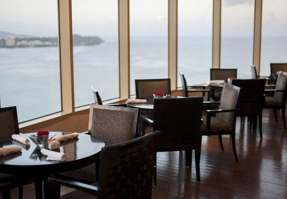 chair property restaurant Ocean living room home Suite condominium set dining table