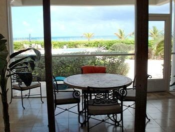 Ocean property cottage home Villa condominium outdoor structure overlooking dining table