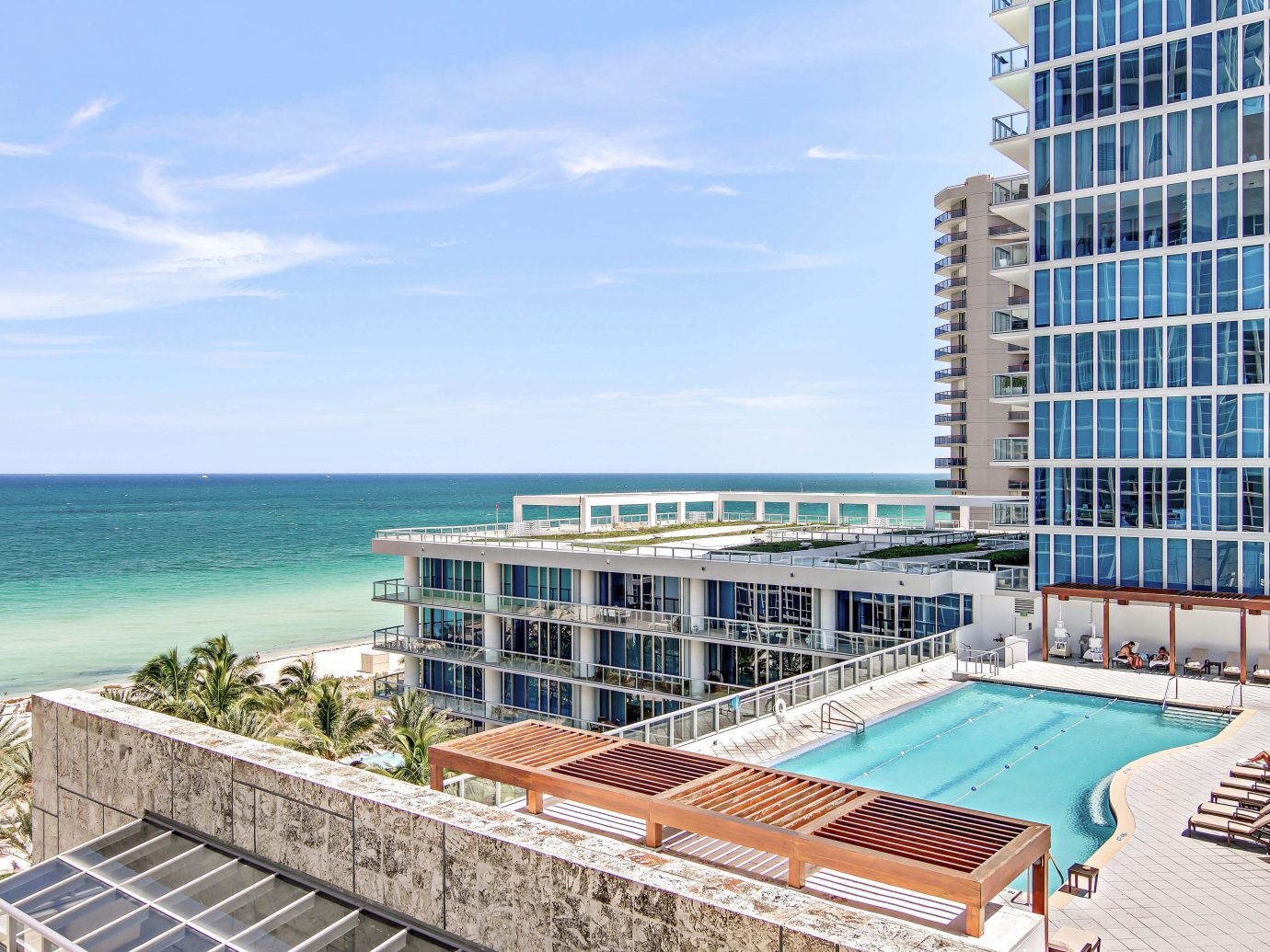 Beach Beachfront City Health + Wellness Hotels Luxury Ocean Romantic Yoga Retreats outdoor condominium property swimming pool Resort real estate facade estate apartment marina dock shore