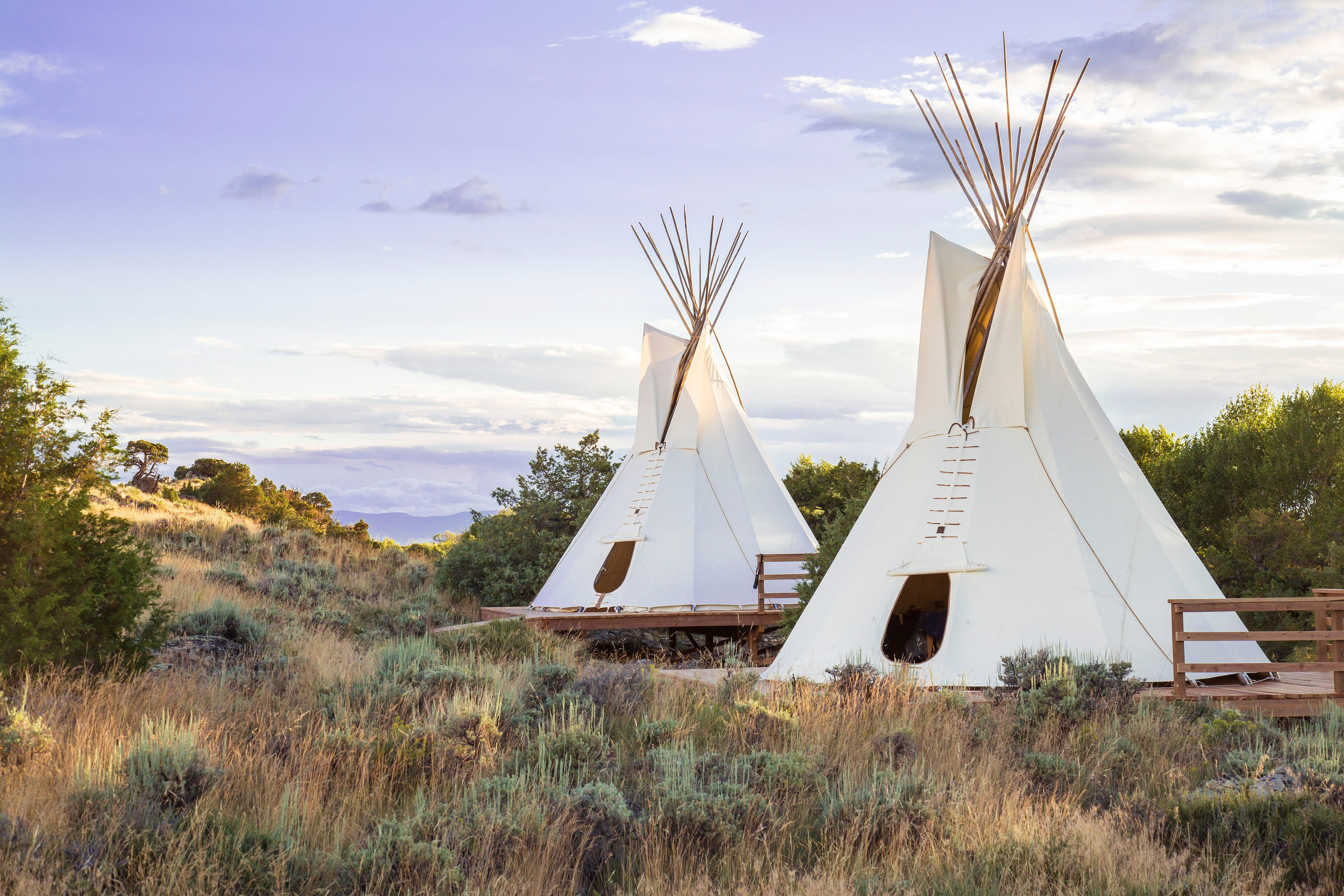 Outdoors + Adventure Trip Ideas tepee building grass sky windmill landmark field rural area mill tower monument wind