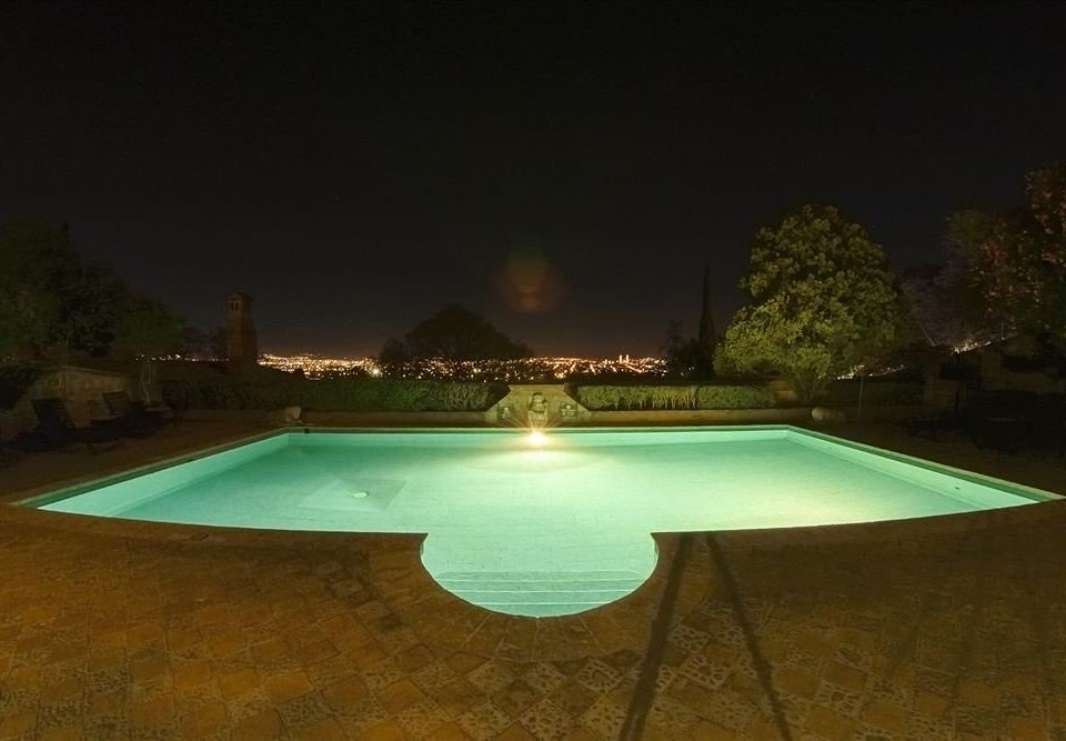 Outdoors Patio Pool swimming pool night light lighting park landscape lighting screenshot Resort backyard