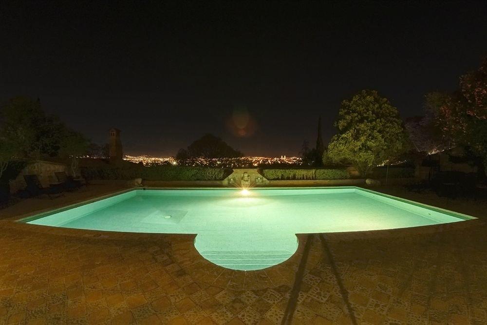 Outdoors Patio Pool swimming pool night light lighting park landscape lighting screenshot Resort backyard