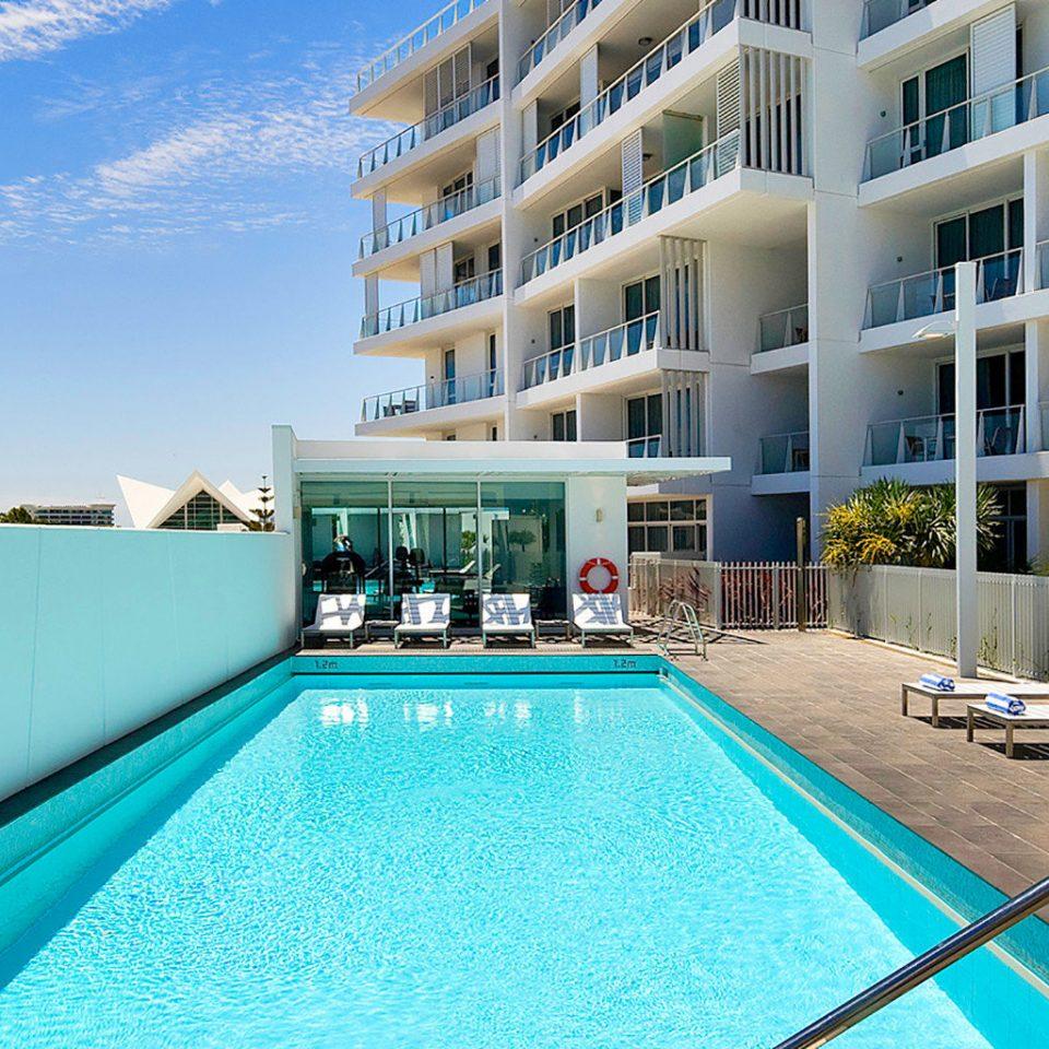 Outdoors Play Pool Resort sky condominium swimming pool property leisure Villa blue