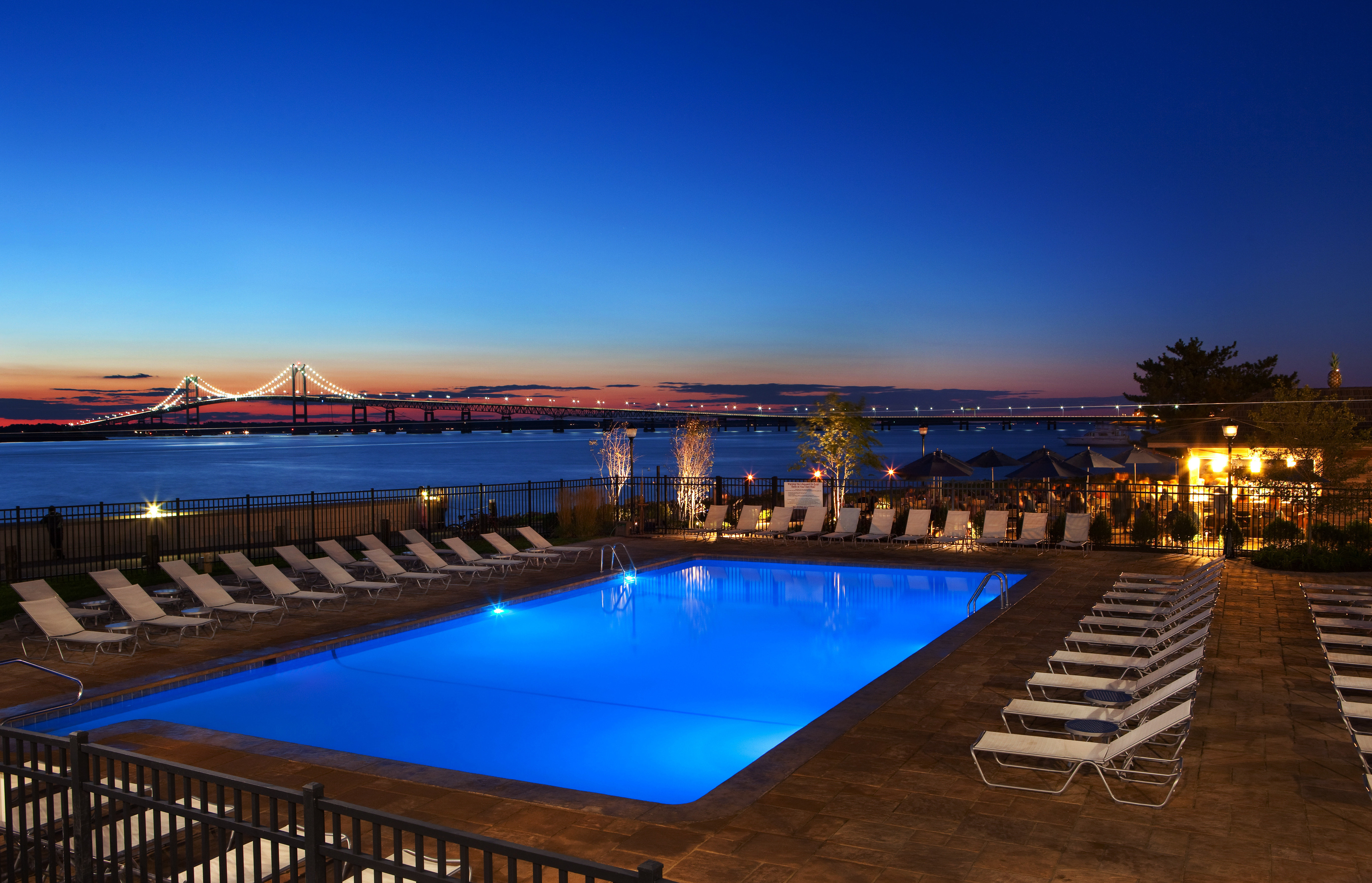 Outdoors Pool Scenic views Waterfront sky water swimming pool pier Resort scene evening dusk marina lined swimming