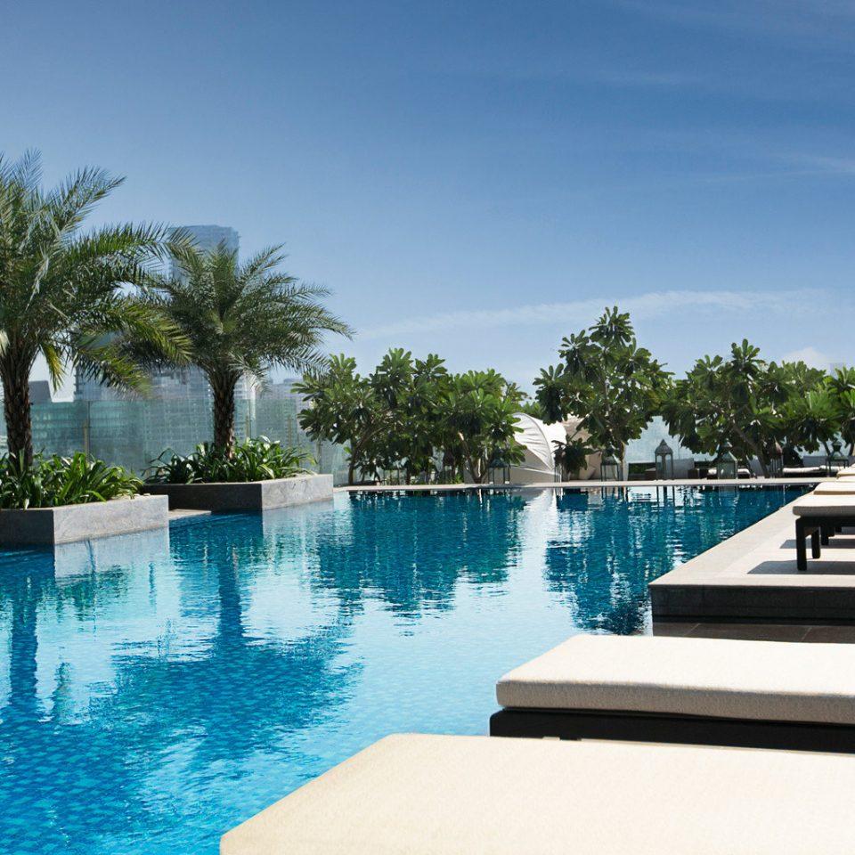 Outdoors Pool Wellness tree sky water swimming pool leisure property Resort reflecting pool Villa condominium