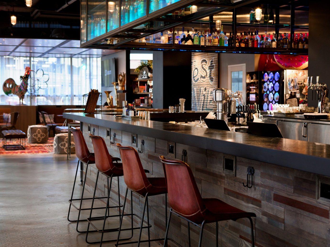 Boutique Hotels indoor floor window ceiling restaurant Bar meal café interior design table area furniture several Island