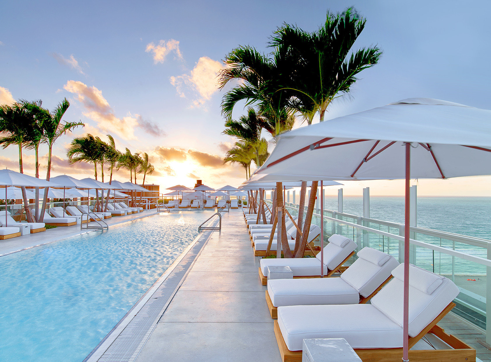 City Hotels Luxury Miami Miami Beach Romance Trip Ideas outdoor sky tree leisure chair Beach swimming pool vacation Resort caribbean Sea Ocean arecales marina dock estate walkway shore lined accessory furniture set sandy several