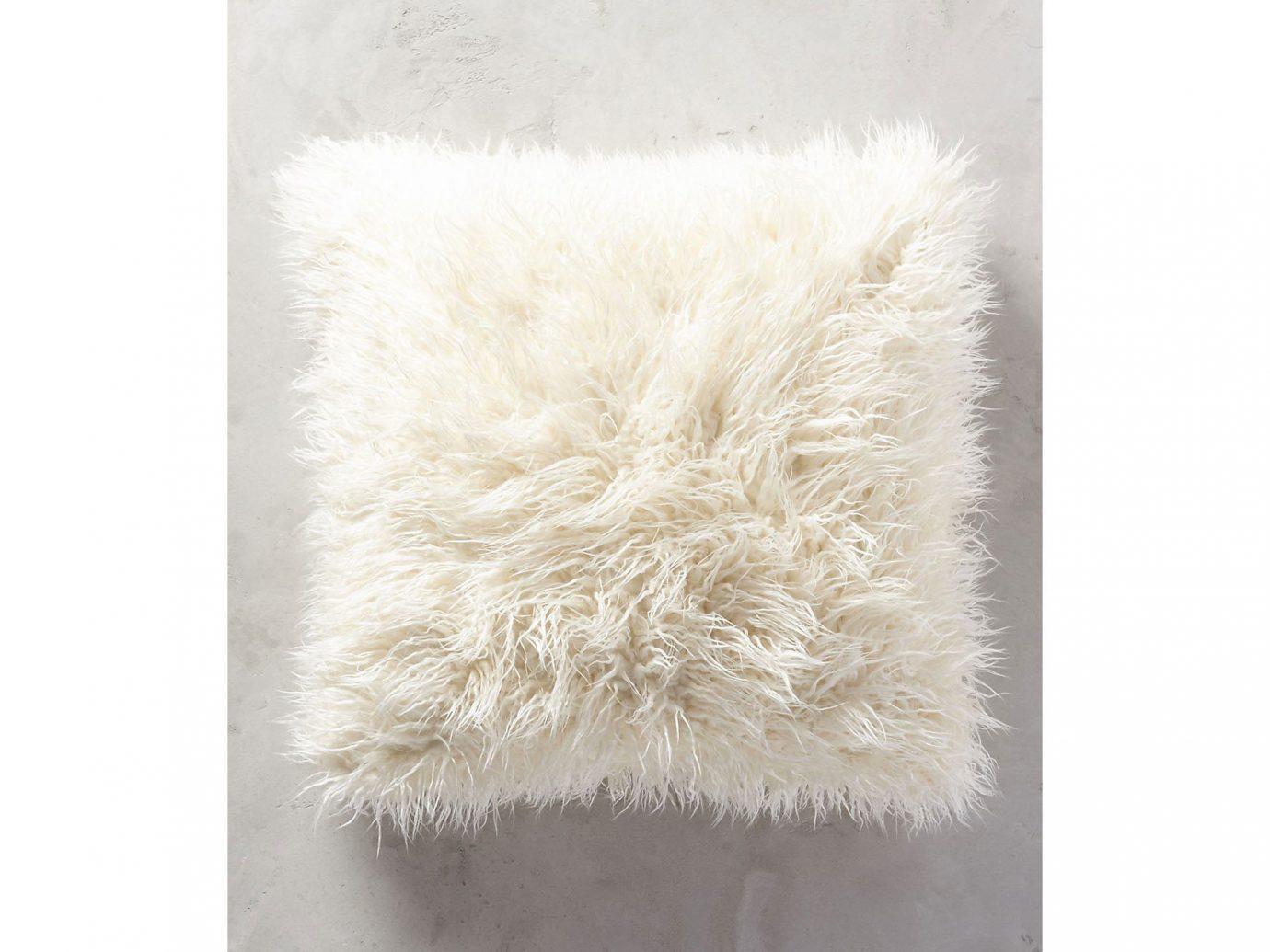 City Copenhagen Kyoto Marrakech Palm Springs Style + Design Travel Shop Tulum fur rug wool cushion feather pillow