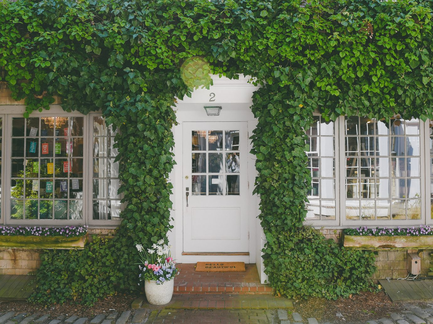 Boutique Hotels Health + Wellness Hotels Trip Ideas tree outdoor property house home building neighbourhood real estate window facade estate Garden Courtyard plant outdoor structure cottage backyard yard landscaping stone bushes