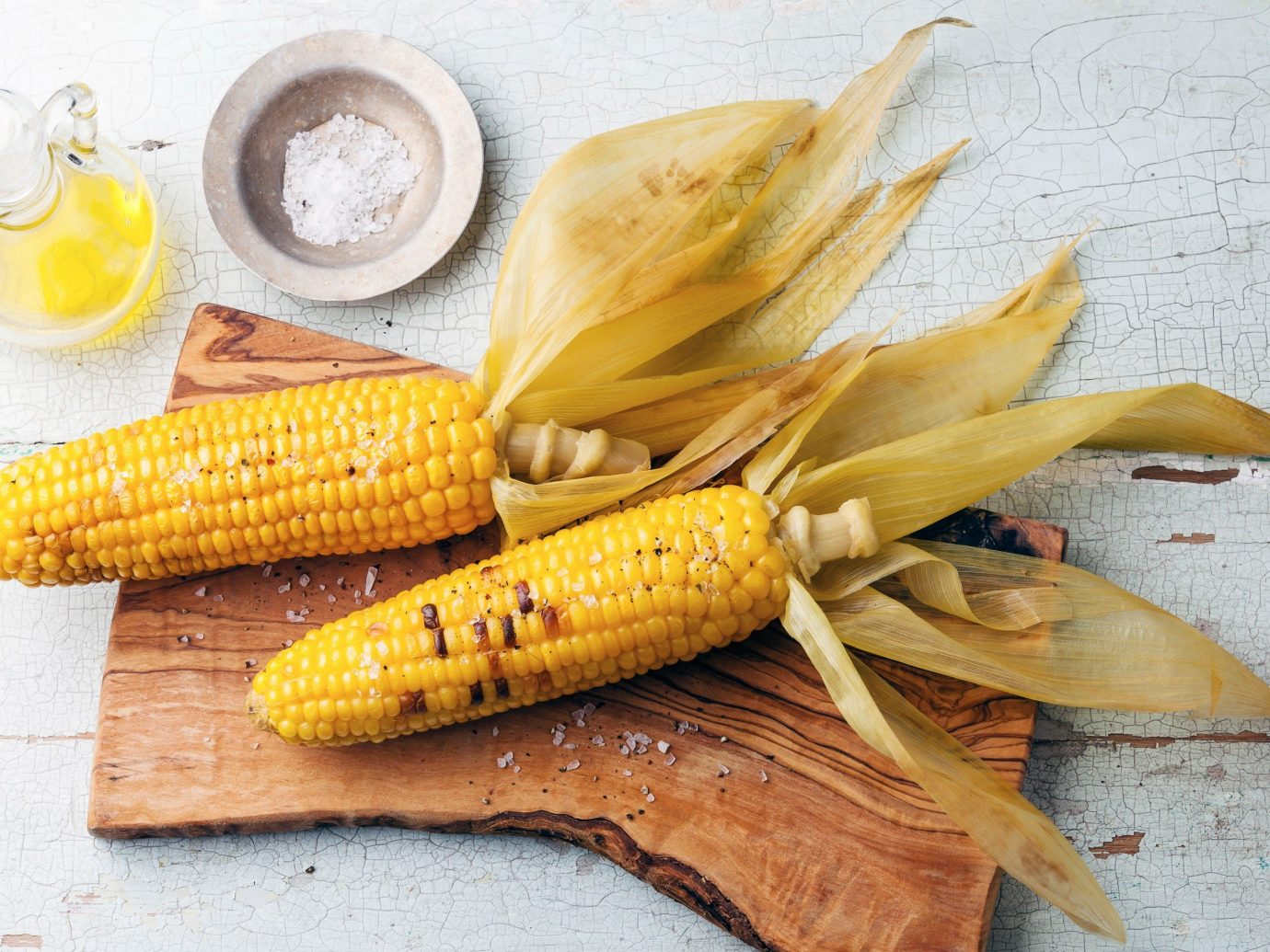 Trip Ideas table food corn on the cob yellow plant corn produce grass family wooden fish vegetable flowering plant dish cuisine meal snack food