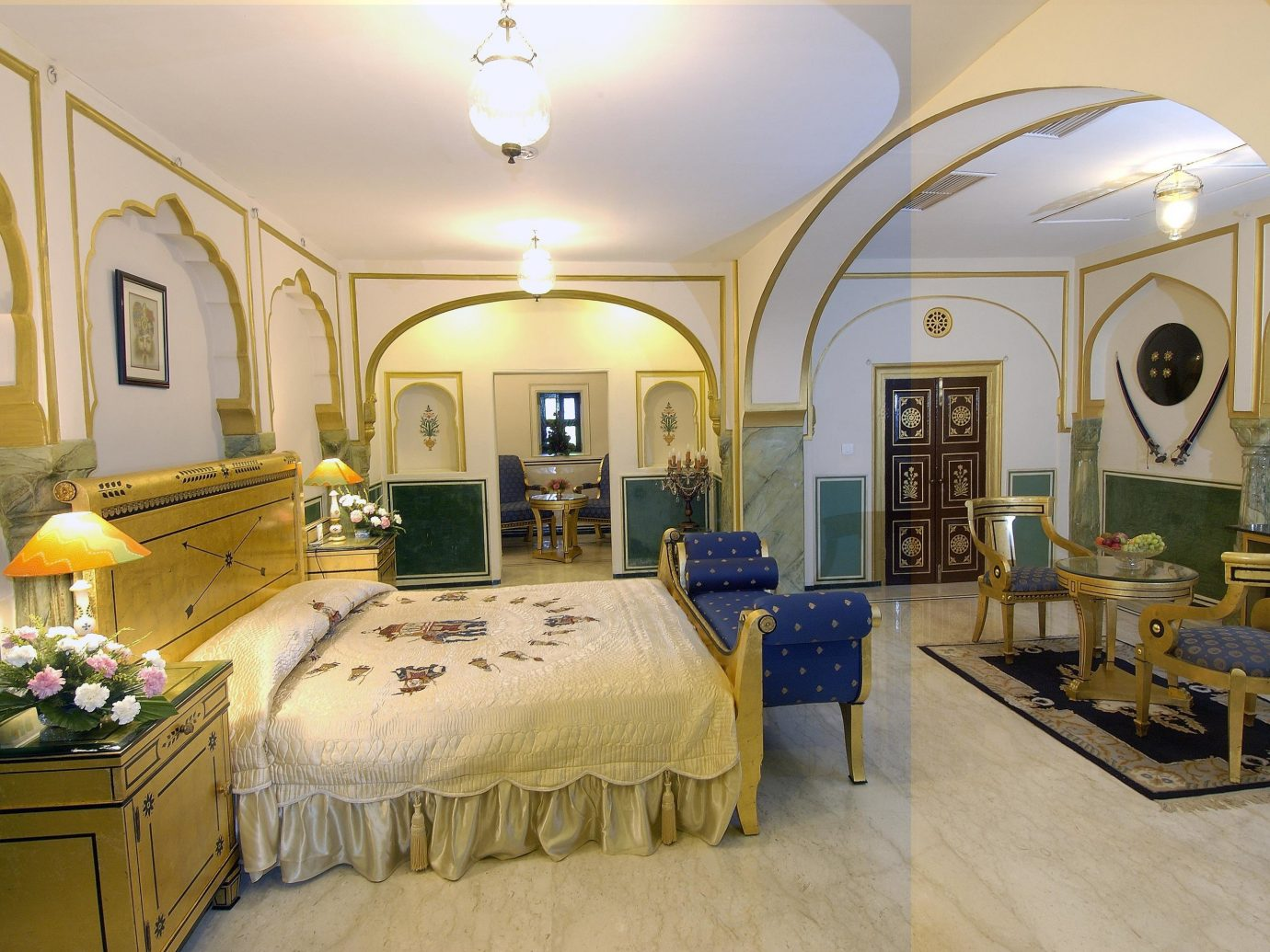 Hotels Luxury Travel indoor wall floor room bed property estate Bedroom home ceiling yellow living room mansion interior design real estate cottage Suite Villa farmhouse furniture
