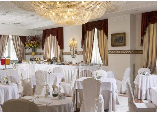 function hall banquet wedding ceremony white wedding reception Party restaurant ballroom centrepiece fancy dining table