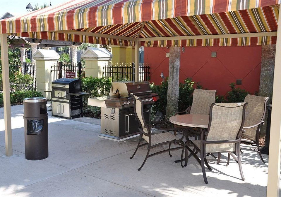 chair property outdoor structure porch restaurant home cottage Patio canopy