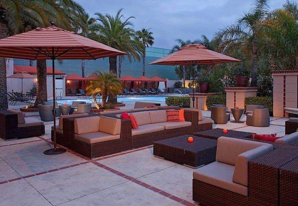 tree property building Resort red Villa outdoor structure backyard swimming pool hacienda Patio condominium cottage