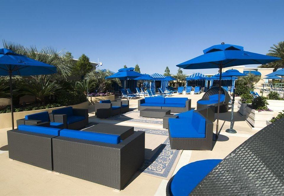 Patio Resort umbrella chair blue tree leisure swimming pool property Villa marina dock set shore