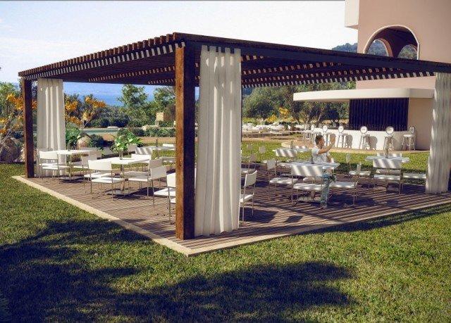 grass building property pergola gazebo outdoor structure porch backyard home Villa Patio house canopy pavilion