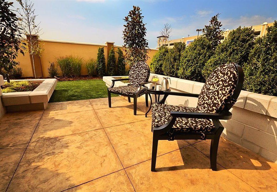 sky tree ground park property home backyard outdoor structure Patio seat Villa flooring stone