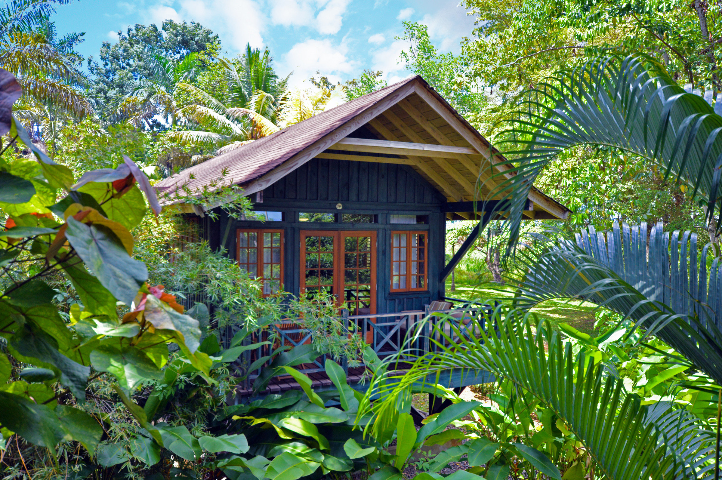 All-Inclusive Resorts caribbean Hotels tree outdoor habitat house botany Resort Garden Jungle rainforest Forest plant cottage flower tropics estate home backyard outdoor structure hut botanical garden