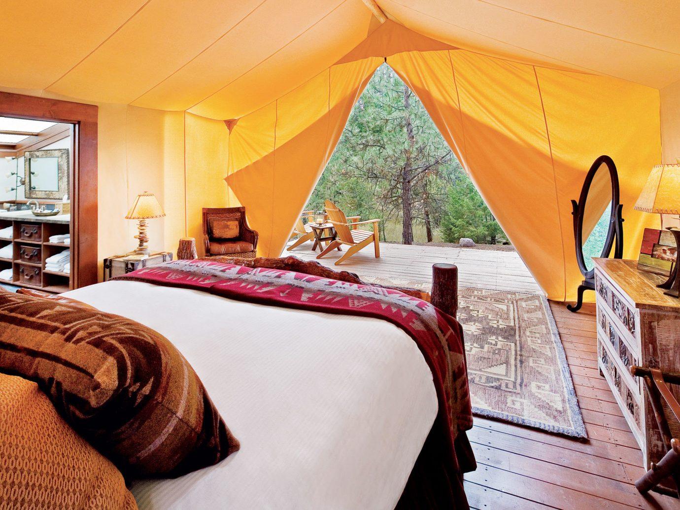 Glamping Hotels Luxury Travel Outdoors + Adventure Trip Ideas indoor room bed Suite Bedroom estate Resort interior design hotel bed sheet cottage furniture