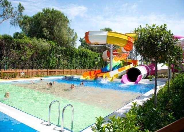tree sky leisure swimming pool Water park amusement park Resort Play park Playground outdoor recreation recreation outdoor play equipment backyard Pool swimming