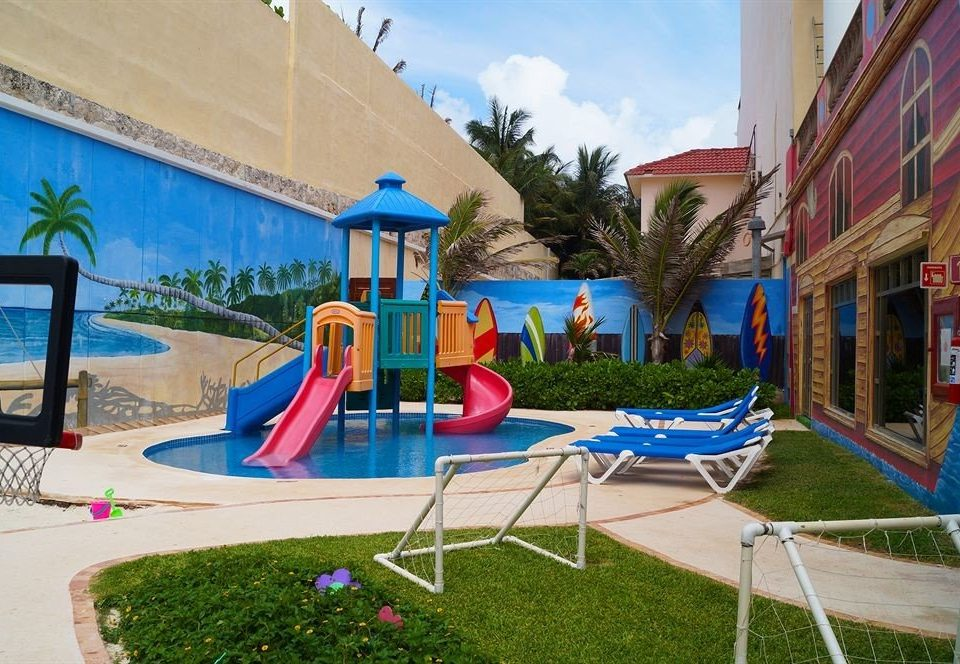 grass sky leisure Resort Playground Play amusement park Water park blue outdoor play equipment lawn swimming pool park backyard seat chair