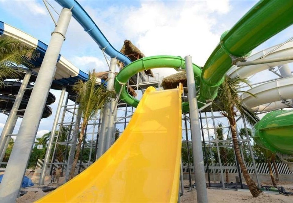 sky amusement park Water park leisure green park slide playground slide outdoor play equipment amusement ride Playground recreation outdoor recreation Play outdoor object nonbuilding structure roller coaster ride