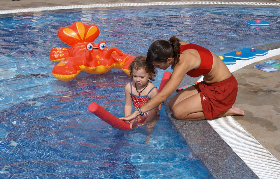 water ground leisure swimming pool Water park Play Pool little boy swimming water sport child orange inflatable Sea
