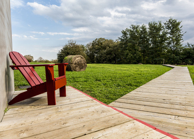 sky ground grass wooden walkway red lawn backyard Playground flooring outdoor structure outdoor play equipment