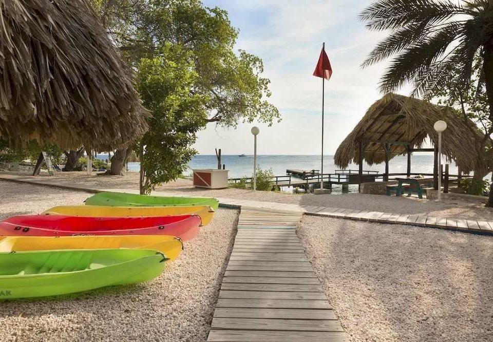 ground tree leisure walkway Playground boating vehicle Resort lined empty sandy