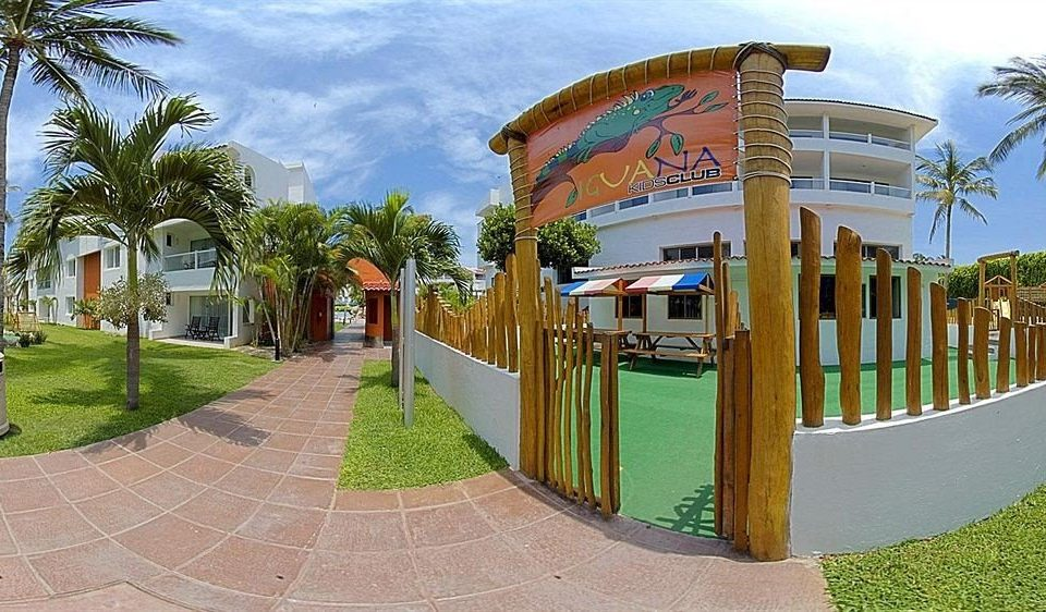 tree grass sky ground leisure property Playground Resort hacienda home walkway Villa park palm
