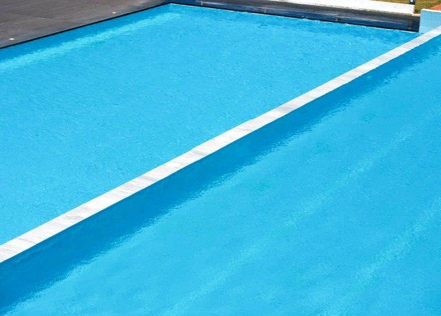 Pool water carom billiards swimming pool cue sports billiard table flooring blue automotive exterior sports games indoor games and sports cue stick swimming
