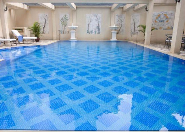Pool swimming pool blue property leisure leisure centre flooring swimming bedclothes