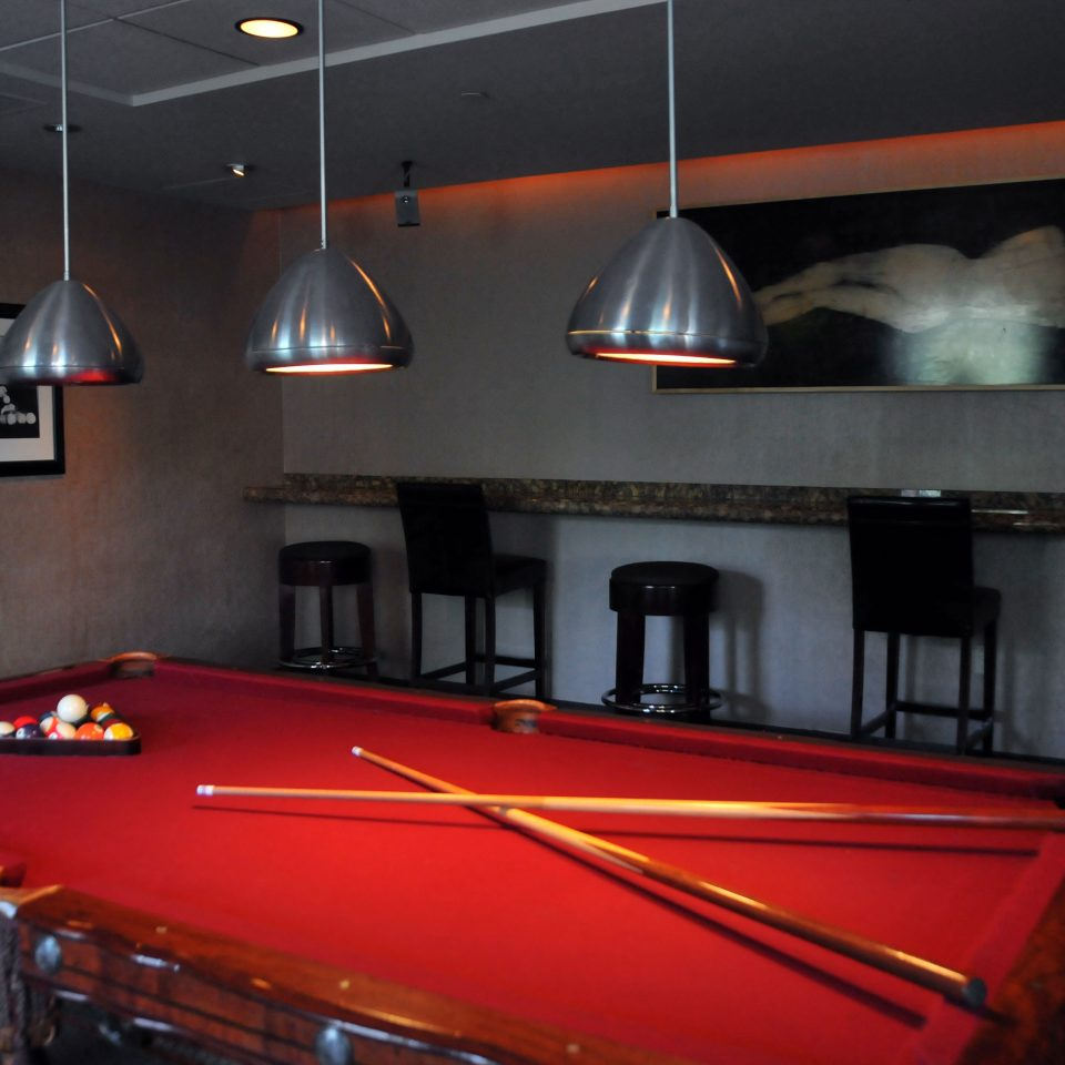 recreation room carom billiards billiard room poolroom pool table red cue sports games Pool indoor games and sports billiard table