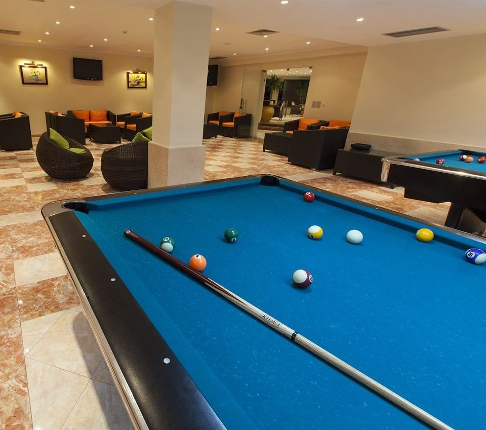 pool table pool ball poolroom Pool cue sports billiard room recreation room carom billiards sports billiard table games indoor games and sports english billiards scene leisure recreation pocket billiards cue stick gambling house individual sports