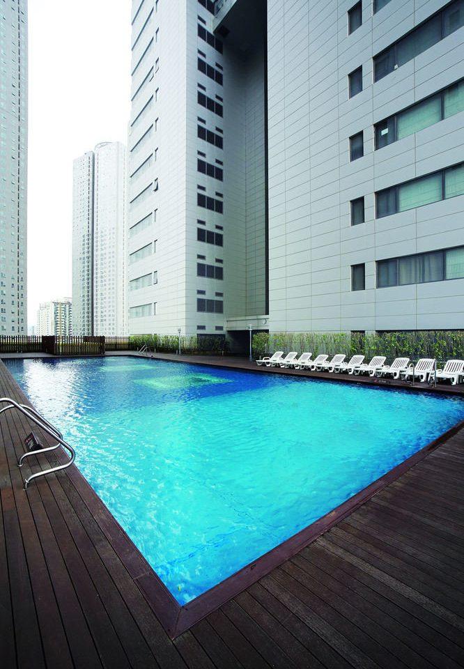 building water swimming pool property condominium reflecting pool Pool