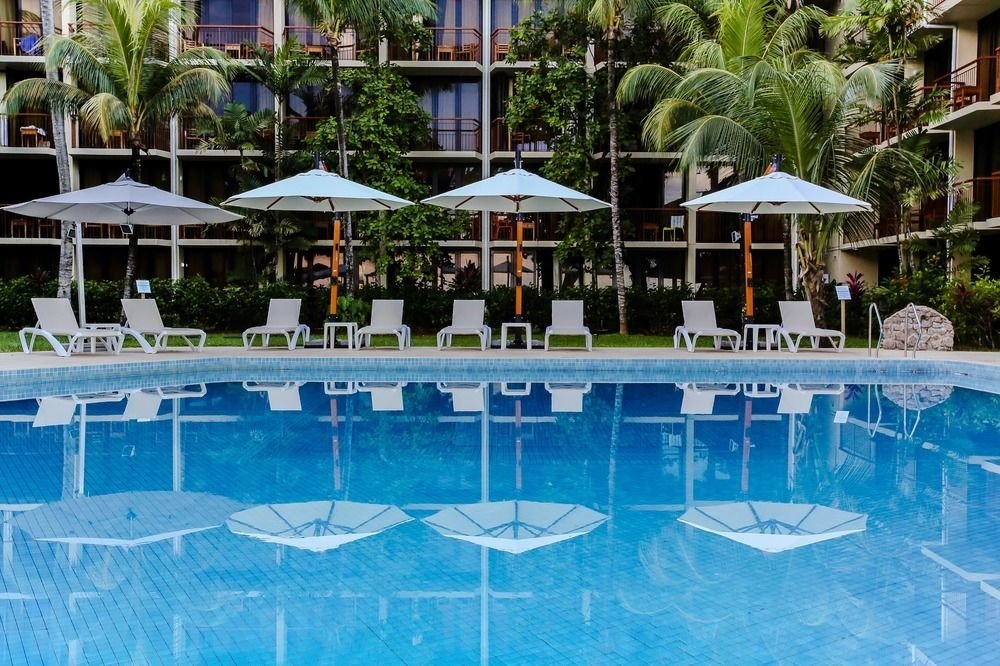 chair umbrella swimming pool leisure Resort property Pool lawn resort town backyard blue swimming