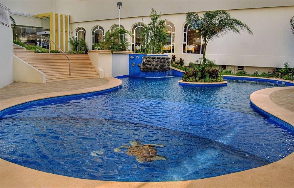 swimming pool Pool property leisure blue reflecting pool Resort backyard jacuzzi swimming