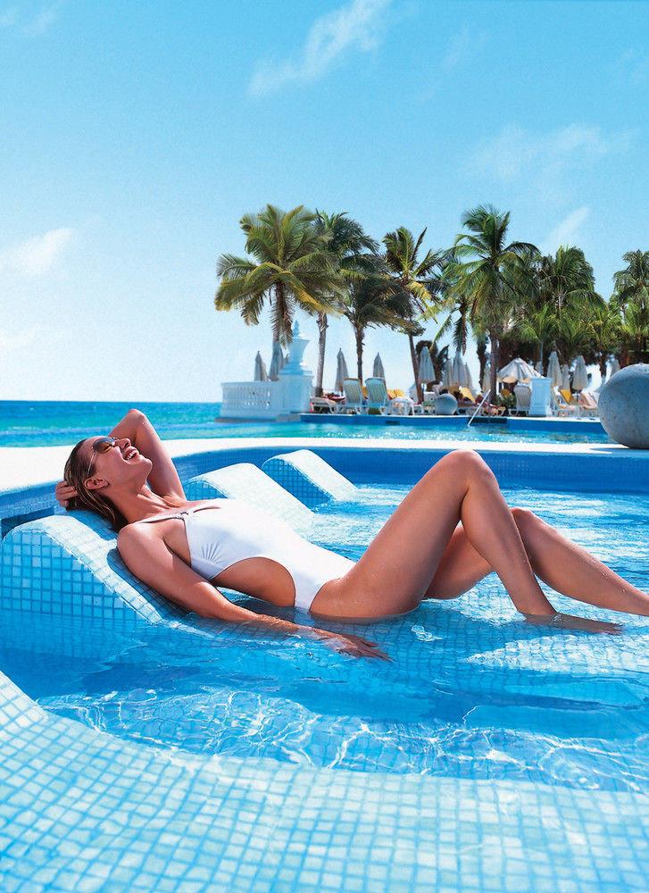 sky water Pool woman leisure swimming pool laying sun tanning caribbean bathtub towel blue vessel lady swimming swimsuit beautiful Resort