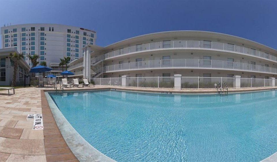 sky swimming pool building property Pool condominium leisure centre reflecting pool Resort blue swimming